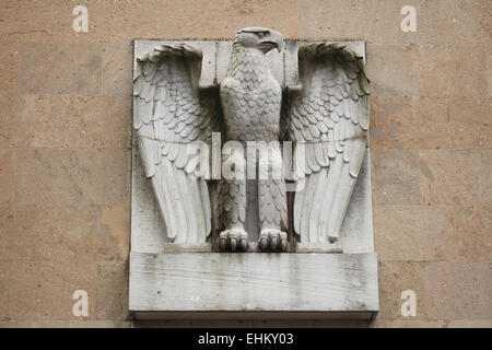 Reichsadler. Nazi eagle from the 1930s on the main building of the Tempelhof Airport in Berlin, Germany. - Stock Photo