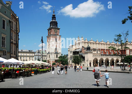 Main Square of Krakow in Poland with Town Hall Tower and Cloth Halls. - Stock Photo