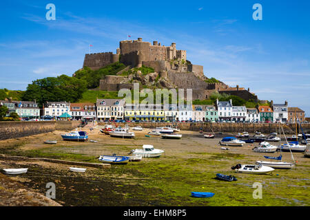 Gorey Harbour and Mont Orgueil Castle at low tide, Jersey, Channel Islands, United Kingdom - Stock Photo