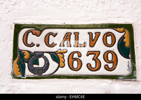 Argentina, Buenos Aires, San Telmo, Av Carlos Calvo, ceramic house number sign - Stock Photo