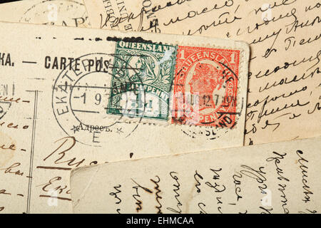 Queen Victoria postage stamps, Australia, Queensland. One penny Red stamp (1897-1911) and one half penny Green stamp. - Stock Photo