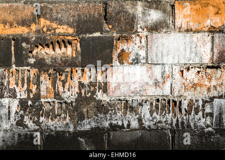 Texture of old red and painted white, yellow brick wall background - Stock Photo