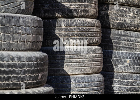 Stack of worn out rubber tire - Stock Photo