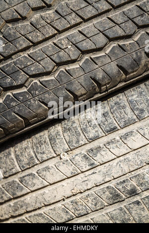 Close view of a stack of worn out rubber tire - Stock Photo