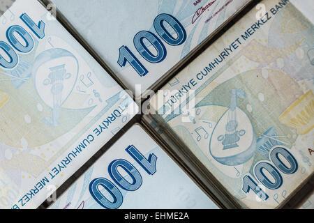 Bunch of Turkish Lira over white wooden background - Stock Photo