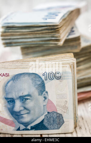 Bunch of Turkish Lira over white wooden background - Stock Photo