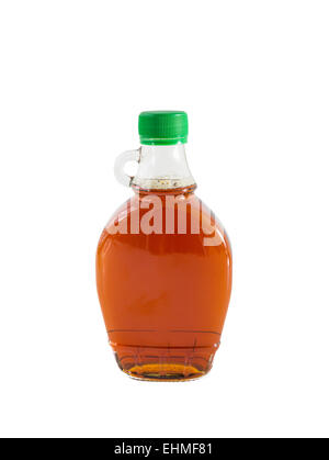 Isolated maple syrup in a bottle. - Stock Photo