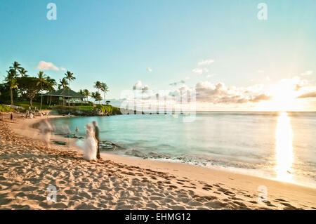 MAUI, HAWAII - SEPTEMBER 4, 2013: long exposure of unidentified couples getting married at sunset on Kaanapali beach - Stock Photo