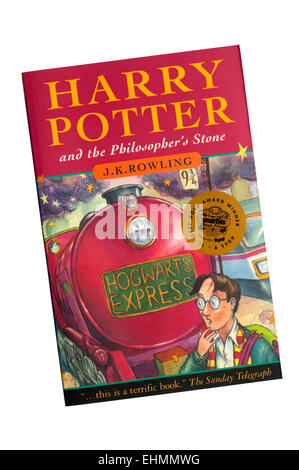 A paperback copy of Harry Potter and the Philosopher's Stone by J.K. Rowling. - Stock Photo
