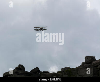 Bi plane in the sky over the Derbyshire Peak District England - Stock Photo