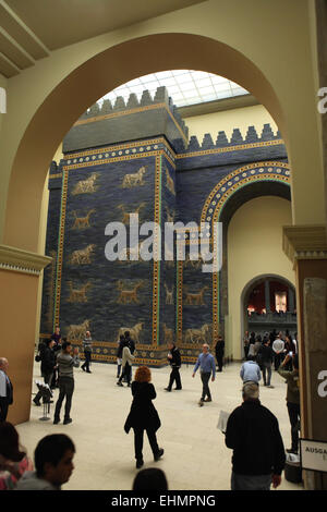 Visitors in front of the Ishtar Gate of Babylon. Pergamon Museum, Berlin, Germany. - Stock Photo