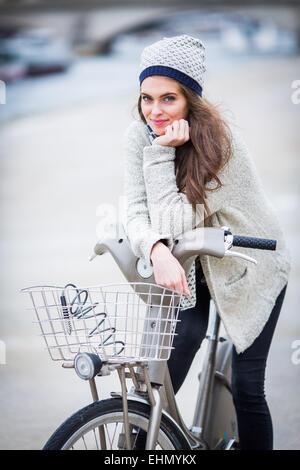 Woman using a Velib bike in Paris, France. - Stock Photo