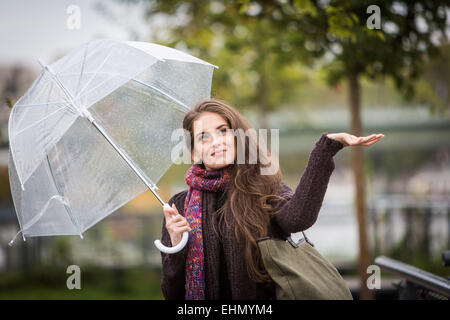 Woman under an umbrella. - Stock Photo