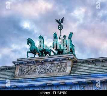 Berlin Brandenburg Gate, Brandenburger Tor. Peace Sculpture chariot and Goddess tops 18th Century neoclassical triumphal - Stock Photo