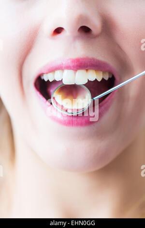 Woman getting dental examination at the dentist.