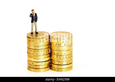 finance financial finances fat cats coins earnings executive executives man management mini miniature money pay - Stock Photo