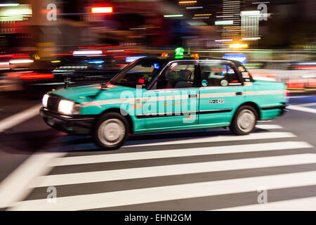 Taxicab in the streets of Tokyo, Japan. - Stock Photo