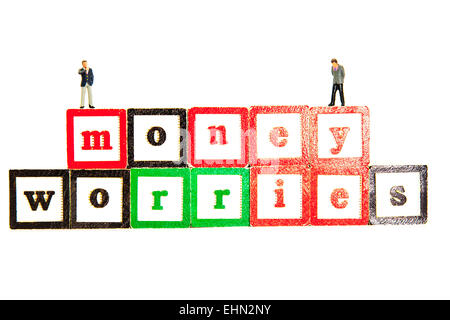money worries worry about debt debts bankruptcy words isolated cut out cutout white background - Stock Photo