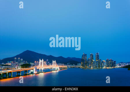 Asia, Republic of Korea, South Korea, Busan, city skyline and Gwangang bridge - Stock Photo