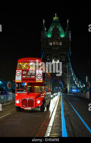 London Transport classic red RM Routemaster double deck bus on London's Tower Bridge - Stock Photo