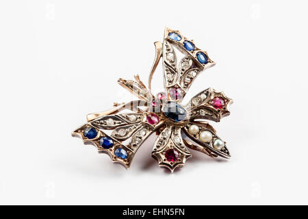 A Victorian diamond and gem set butterfly brooch. - Stock Photo