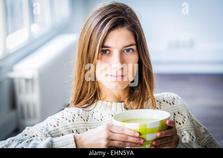 Woman eating a soup. - Stock Photo