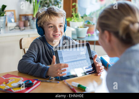 8 year old boy using tablet computer. - Stock Photo