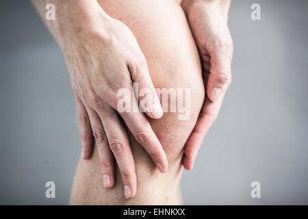 Woman knee pain. - Stock Photo