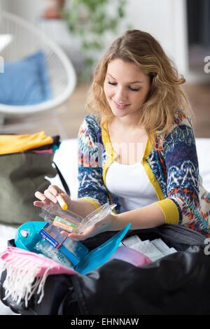 Woman preparing first aid kit. - Stock Photo