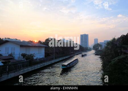 Boat speeding on San Saep canal in Bangkok, Thailand - Stock Photo