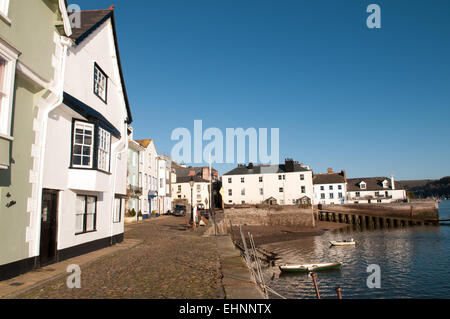 Historic beautiful Bayards Cove in Dartmouth, Devon, UK with Grade I listed buildings, cobbled quayside, boats bobbing - Stock Photo