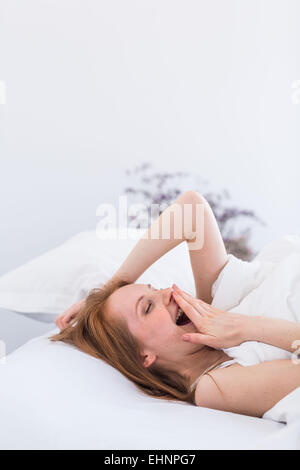 Woman yawning. - Stock Photo