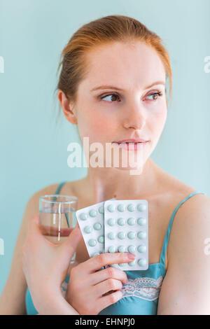 Woman taking medicines. - Stock Photo