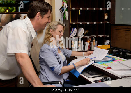 Receptionist explained staff documents - Stock Photo