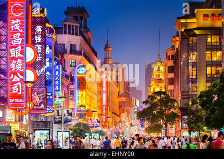 Neon signs lit on Nanjing Road in Shanghai, China. - Stock Photo