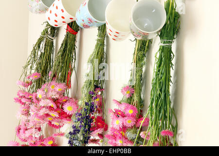 Dried flowers hanging in the kitchen - Stock Photo