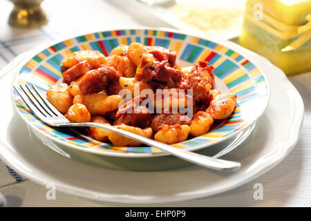 Homemade italian gnocchi noodle with red sauce - Stock Photo