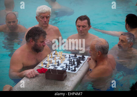 Men playing chess  in the Szechenyi thermal baths, Budapest, Hungary - Stock Photo