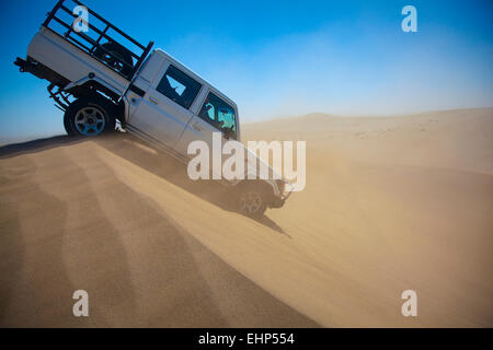 Dune bashing on a windy day in the Namib Desert, Namibia - Stock Photo