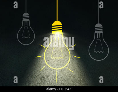 Drawing light bulb on cement wall - Stock Photo