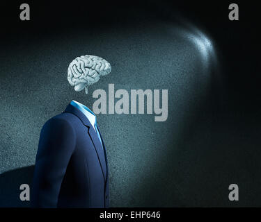 Businessman without head just with sketched brain - Stock Photo