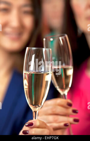 Toasting with a glass of champagne or prosecco. - Stock Photo