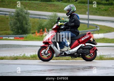 Moped driver training for young people - Stock Photo