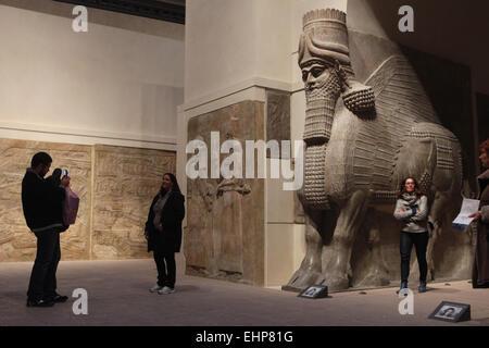 Lamassu. Assyrian human-headed winged bull from the Palace of King Sargon II in Dur Sharrukin. Louvre Museum, Paris, - Stock Photo