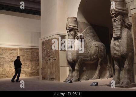 Lamassu. Assyrian human-headed winged bulls from the Palace of King Sargon II in Dur Sharrukin. Louvre Museum, Paris, - Stock Photo