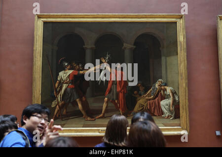 Visitors in front of painting 'Oath of the Horatii' (1784) by French painter Jacques-Louis David. Louvre Museum, - Stock Photo
