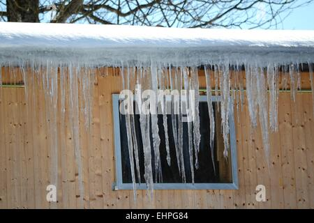 Icicle outside the window - Stock Photo