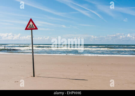 danger label at the North Sea - Stock Photo