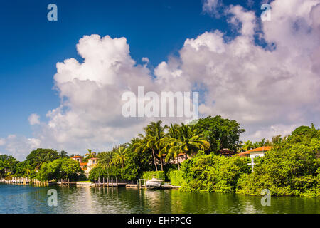Houses along Collins Canal in Miami Beach, Florida. - Stock Photo