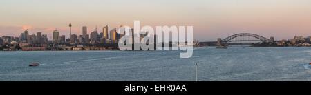 Cruising into Sydney harbour early morning during sunrise. - Stock Photo
